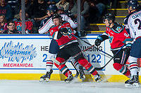 KELOWNA, CANADA - OCTOBER 27: Ted Brennan #10 of the Kelowna Rockets checks a player of the Tri-City Americans into the boards during first period on October 27, 2017 at Prospera Place in Kelowna, British Columbia, Canada.  (Photo by Marissa Baecker/Shoot the Breeze)  *** Local Caption ***
