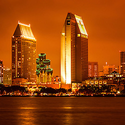 Photo of San Diego skyline at night along San Diego Bay with downtown city office buildings and skyscrapers. Image is high resolution and was taken in 2012.