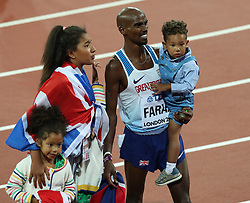 London, 2017-August-04. Mo Farah celebrates his victory in the Men's10,000m with his family at the IAAF World Championships London 2017. Paul Davey.
