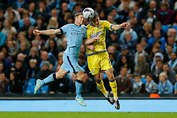 James Milner of Manchester City and Lewis Buxton of Sheffield Wednesday compete in the air - Photo mandatory by-line: Rogan Thomson/JMP - 07966 386802 - 24/08/2014 - SPORT - FOOTBALL - Manchester, England - Etihad Stadium - Manchester City v Sheffield Wednesday - Capital One Cup, Third Round.
