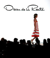 A model walks through the catwalk wearing the Dominican Republic Designer Oscar de la Renta's clothes during the fashion event named XI Romantic Night, at the Figali Convention Center on Tuesday April 12, 2005 in Panama City, Panama. (AP Photo/Cristobal Herrera) **EFE OUT**
