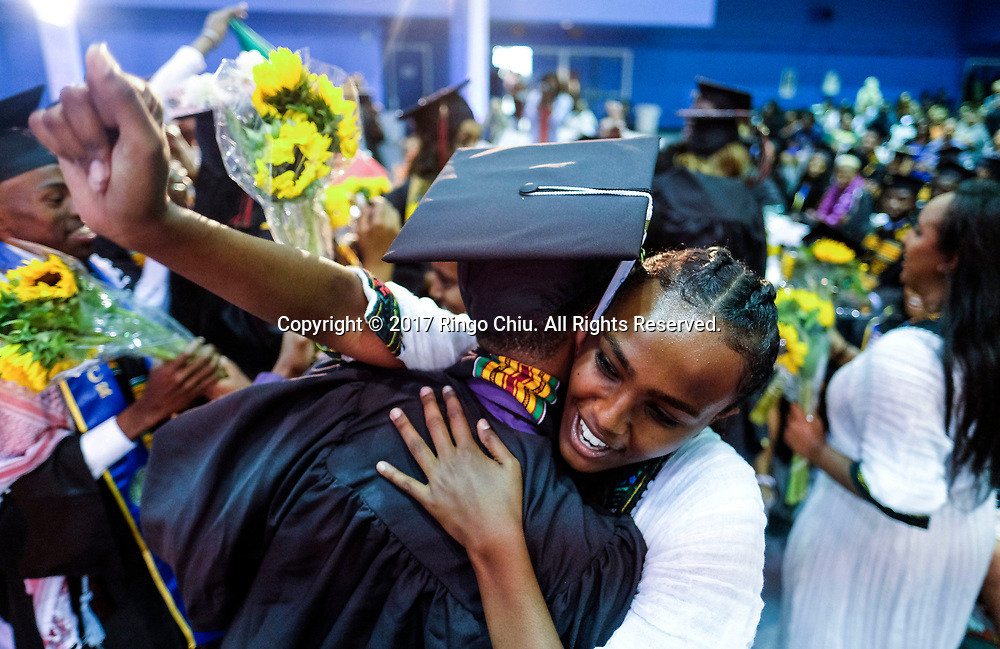 RIVERSIDE, CA - JUNE 11, 2017: Graduates greets each other during the Black Graduation Ceremony at University of California, Riverside, Sunday June 11, 2017. (Photo by Ringo H.W. Chiu / For The Times)(Photo by Ringo Chiu)<br /> <br /> Usage Notes: This content is intended for editorial use only. For other uses, additional clearances may be required.