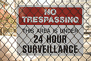 No trespassing sign on a fenced off area