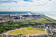 Nederland, Noord-Holland, IJmuiden, 01-08-2016; Wijk aan Zee met Terrein van Tata Steel met hoogovens.<br /> Tata Steel industrial site, steel works, seen from the village Wijk aan Zee.<br /> <br /> luchtfoto (toeslag op standard tarieven);<br /> aerial photo (additional fee required);<br /> copyright foto/photo Siebe Swart