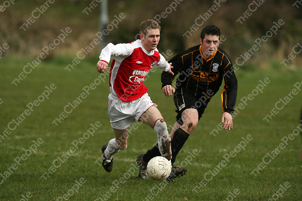 Corofin's Dean Lee tries to hold off Hermitage's Ross Finn during their cup game in Corofin on Sunday morning.<br /> Photograph by Yvonne Vaughan