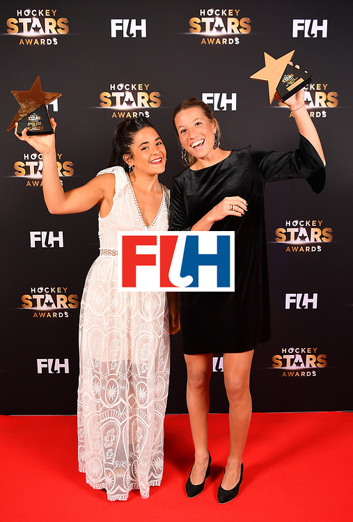 BERLIN, GERMANY - FEBRUARY 05:  Maria Granatto  and Delfina Merino  of Argentina  with eir awards during the Hockey Star Awards night at Stilwerk on February 5, 2018 in Berlin, Germany.  (Photo by Stuart Franklin/Getty Images For FIH)