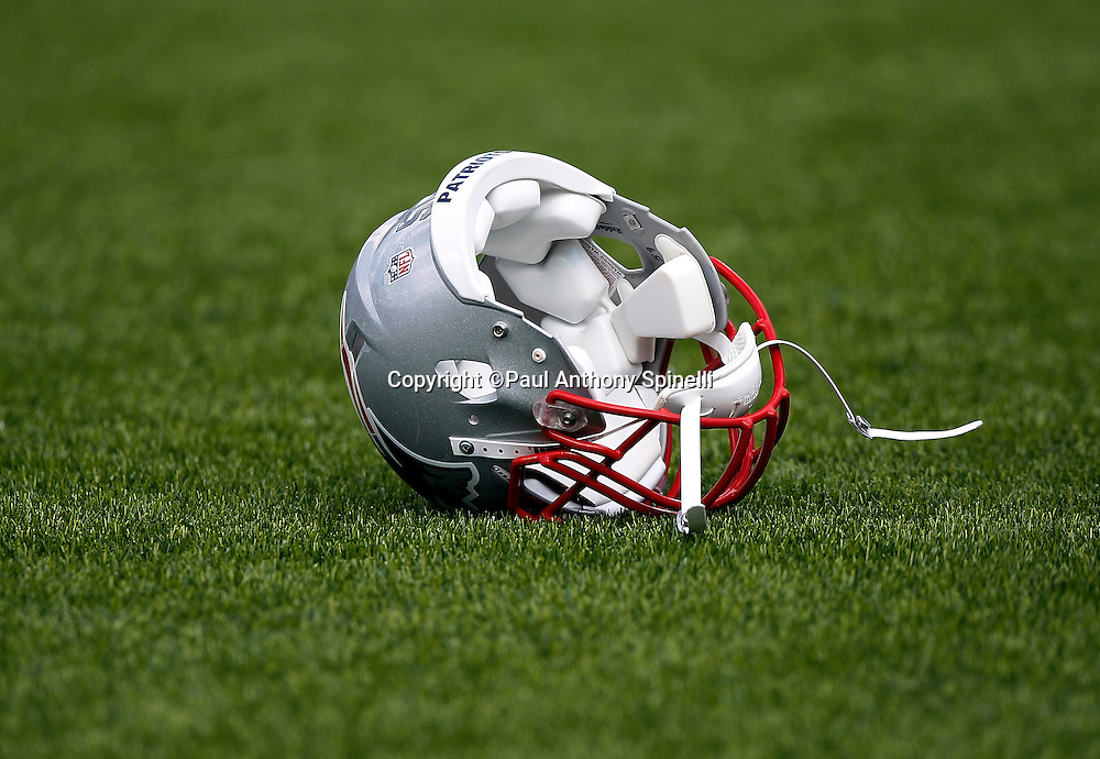 A New England Patriots helmet lies upended and upside down on the grass at the Buffalo Bills NFL week 3 football game on Sunday, September 25, 2011 in Orchard Park, New York. The Bills won the game 34-31. ©Paul Anthony Spinelli