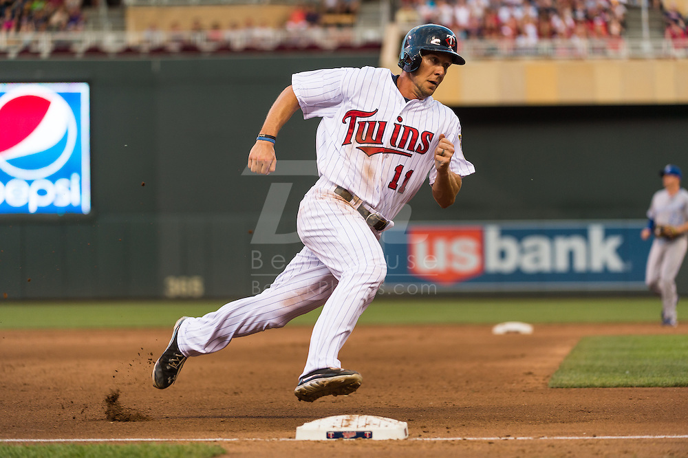 Clete Thomas #11 of the Minnesota Twins rounds 3rd base against the Kansas City Royals on June 27, 2013 at Target Field in Minneapolis, Minnesota.  The Twins defeated the Royals 3 to 1.  Photo by Ben Krause