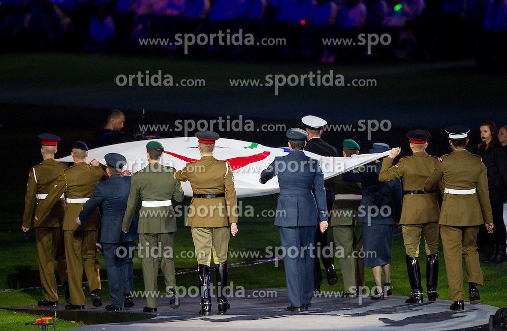 The Paralympic flag is lowered by members of the Ministry of Defence during the closing ceremony of the London 2012 Paralympic Games on September 9, 2012, in Olympics stadium, Stratford, London, Great Britain. (Photo by Vid Ponikvar / Sportida.com)
