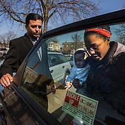 "WASHINGTON, DC - APR 4:  UberX driver, Sanjiv Kumar, a former Washington Flyer driver, holds the door open for passenger Chandra Scott and her son Liam, 9 months, as she gets out of the car, April 9, 2014, in Washington, DC. Thousands of local car owners have signed up in recent months to drive with one of the ""ride-share"" operators that use smartphone apps to link people needing rides with car owners willing to give them, for a price. (Photo by Evelyn Hockstein/For The Washington Post)"