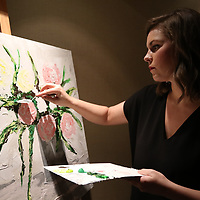 Caroline Riley paints during the Gum Tree Museum of Art's For the Love of Art Gallery Saturday