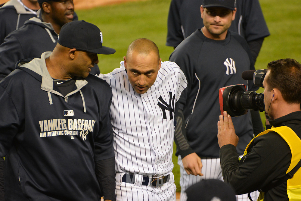 Derek Jeter is joined by CC Sebathia (l.) as the network television cameras capture Derek up-close and personal following his final game at Yankee Stadium.