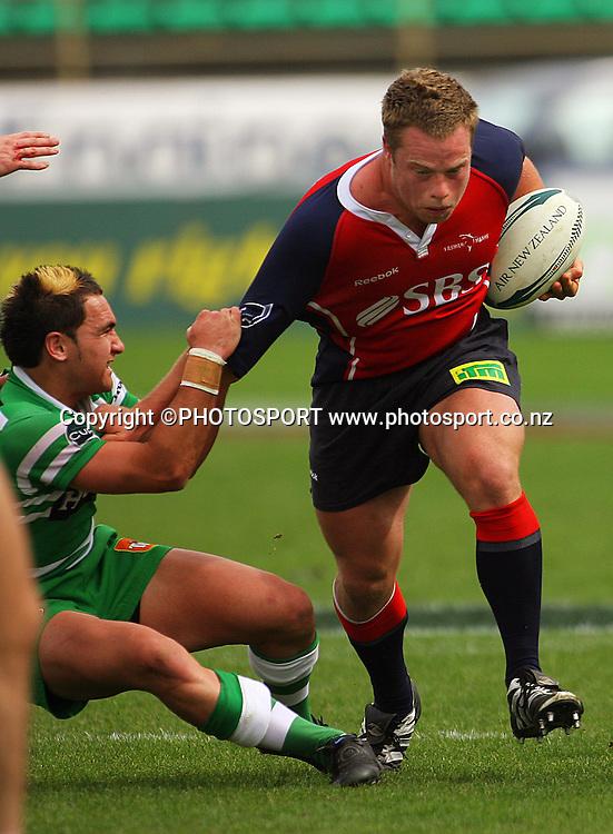 Matty James tries to bring down Tristan Moran.<br /> Air NZ Cup. Manawatu Turbos v Tasman Makos at Arena Manawatu, Palmerston North, New Zealand, Saturday, 4 October 2008. Photo: Dave Lintott/PHOTOSPORT