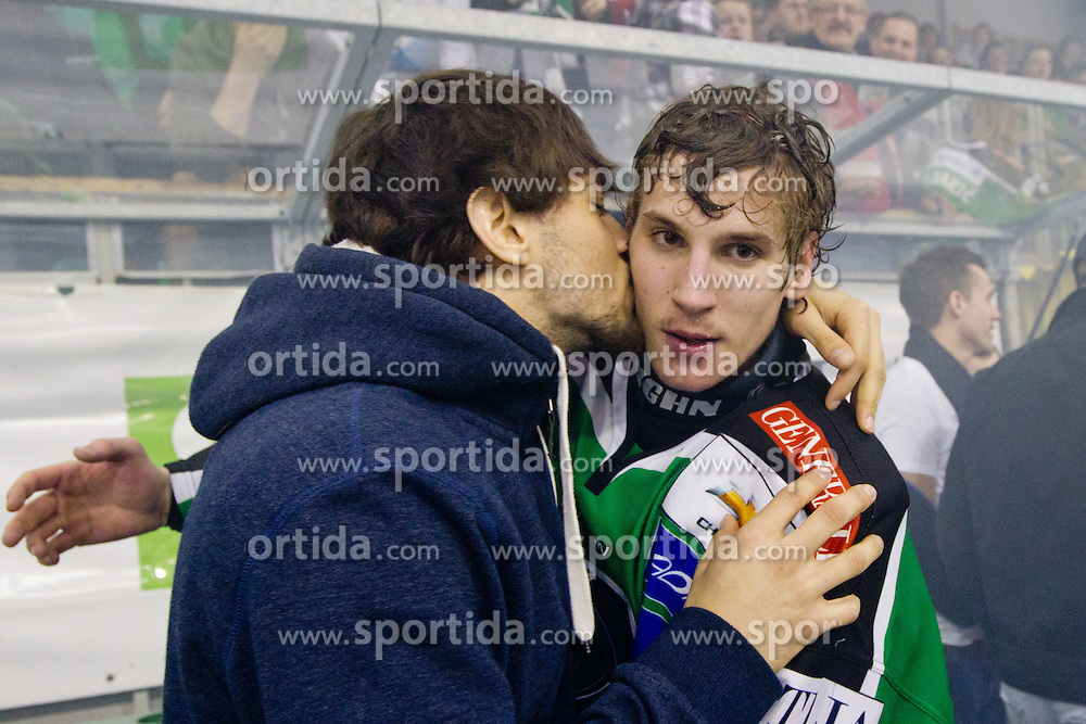 Matija Pintaric (HDD Tilia Olimpija, #69) and Matic Boh (HDD Tilia Olimpija, #20) during ice-hockey match between HDD Tilia Olimpija and SAPA Fehervar AV19 at sixth match in Quarterfinal  of EBEL league, on March 1, 2012 at Hala Tivoli, Ljubljana, Slovenia. HDD Tilia Olimpija won 4:3. (Photo By Matic Klansek Velej / Sportida)