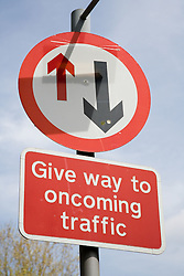 Sign instructing drivers to give way to oncoming traffic,