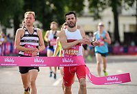 The first runners in the first Adult Wave cross the finish line outside Buckingham Palace. The Vitality Westminster Mile, Sunday 28th May 2017.<br /> <br /> Photo: Thomas Lovelock for The Vitality Westminster Mile<br /> <br /> For further information: media@londonmarathonevents.co.uk