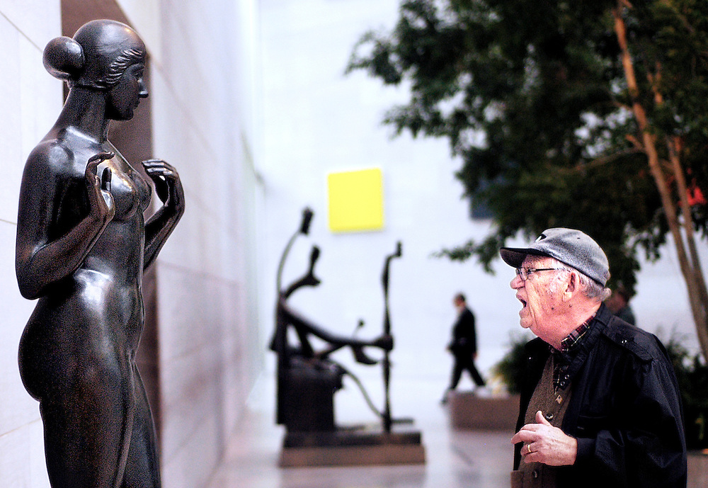 On his way to wait for the bus Seymour Barondes, 85, examines Aristide Maillol's Venus statue, wondering if the second of the two years attributed to the piece's name on the info plate, 1918/1928, refers to a rebronzing. A group of senior volunteers from the Howard County Hospital made a Veteran's Day day trip to DC and visited the new WWII memorial and the National Museum of Art.