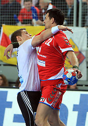 Michael Kraus (18) of Germany holding Marcin Lijewski (22) of Poland during 21st Men's World Handball Championship preliminary Group C match between National teams of Germany and Poland, on January 22, 2009, in Arena Varazdin, Varazdin, Croatia.  (Photo by Vid Ponikvar / Sportida)