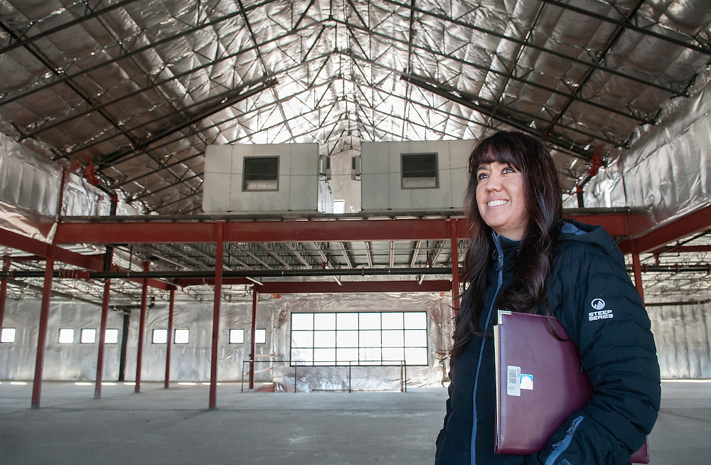 Commissioner Paula Garcia walks through the shell of the Mora County Courthouse still unfinished. Photo taken in Mora, Wednesday, Nov. 12, 2014. Mora County started construction on the courthouse in 2009 but have not had enough money to complete the project. (Eddie Moore/Albuquerque Journal)