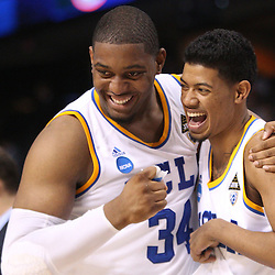 Mar 17, 2011; Tampa, FL, USA; UCLA Bruins center Joshua Smith (34) and guard Tyler Lamb (1) celebrate following a win over the Michigan State Spartans in the second round of the 2011 NCAA men's basketball tournament at the St. Pete Times Forum. UCLA defeated Michigan State 78-76.  Mandatory Credit: Derick E. Hingle