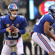 New York Giants quarterback Eli Manning in action during the New York Giants V San Francisco 49ers, NFL American Football match at MetLife Stadium, East Rutherford, NJ, USA. 16th November 2014. Photo Tim Clayton