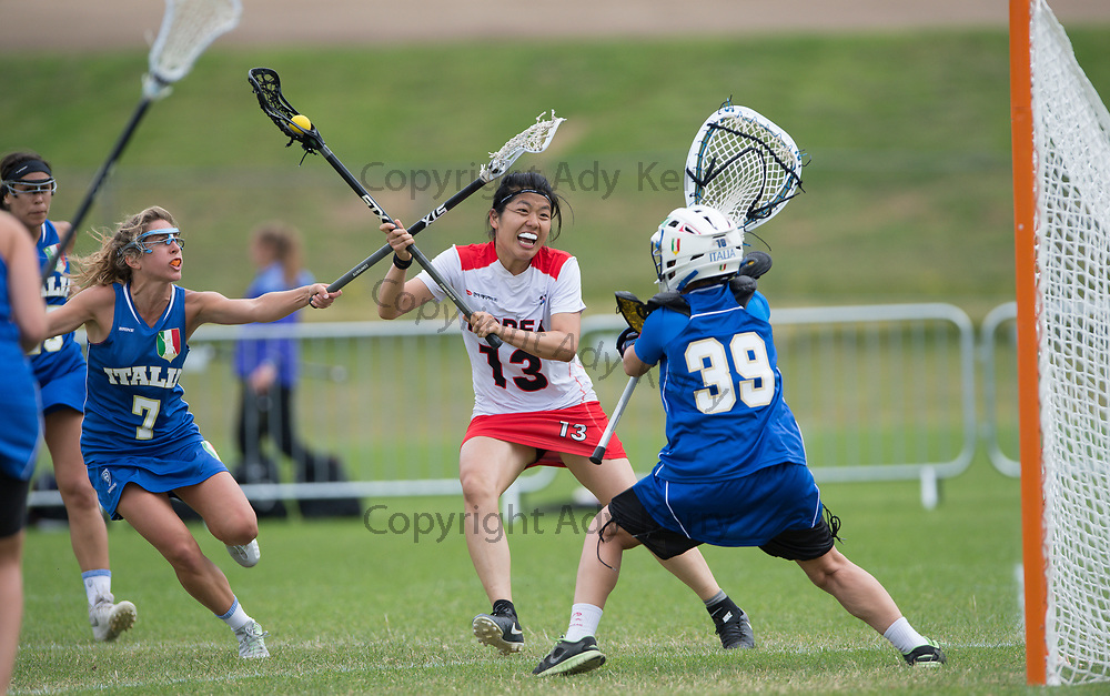 Korea's  Jy Hyun Song sxcores against Italy at the 2017 FIL Rathbones Women's Lacrosse World Cup, at Surrey Sports Park, Guildford, Surrey, UK, 15th July 2017.