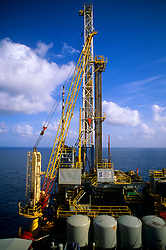 Stock photo of a crane on a rig in the ocean