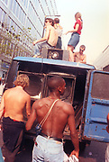 Ravers cheering from their truck, 2nd Criminal Justice March, Victoria, London, UK, 23rd of July 1994.