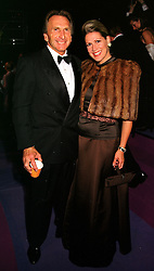 MR & MRS DEREK BELL he is the former Le Mans 24 hour winner, at a ball in West Sussex on 18th September 1999.MWL 53