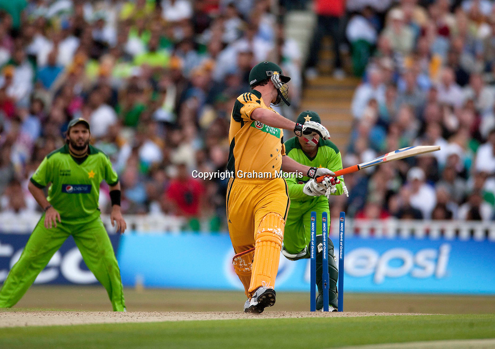 Last man Shaun Tait is stumped by Kamran Akmal during the first International T20 match between Australia and Pakistan at Edgbaston, Birmingham.  Photo: Graham Morris (Tel: +44(0)20 8969 4192 Email: sales@cricketpix.com) 05/07/10