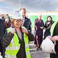 Mr. Luke Gibbins of BAM Building Contractors providing PPE to the Minister of Education and Science, Ms Jan O'Sullivan TD before the turning of the sod ceremony for the new Tulla Secondary School