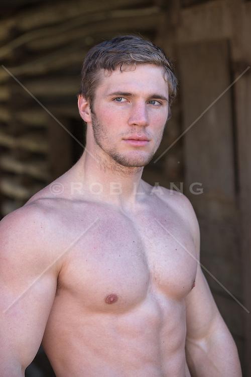 hot man without a shirt outdoors
