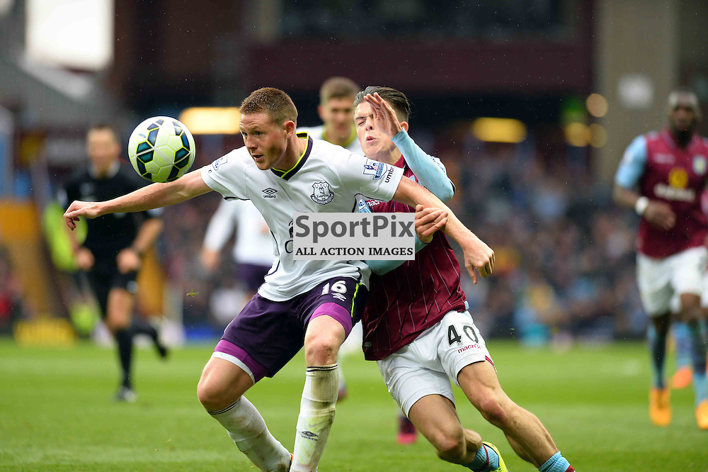 Aston Villa player Jack Grealish and Everton player James McCarthy fight for the ball