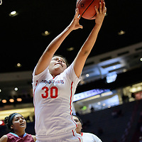031015  Adron Gardner/Independent<br /> <br /> Shiprock Chieftain Tia Woods (30) grabs a rebound during the New Mexico state basketball tournament at The Pit in Albuquerque Tuesday.