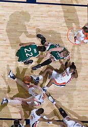 All fall down -- a play in the second half send several Virginia and Charlotte players to the court.  The Virginia Cavaliers women's basketball team defeated The University of North Carolina - Charlotte 49ers 74-72 in the 2nd round of the Women's NIT at John Paul Jones Arena in Charlottesville, VA on March 19, 2007.