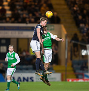 24th January 2018, Dens Park, Dundee, Scottish Premiership, Dundee versus Hibernian; Dundee's Mark O'Hara competes in the air with Hibernian's John McGinn