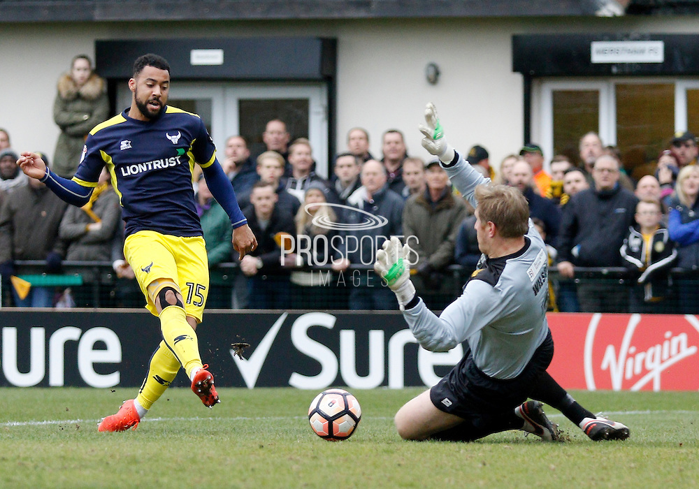 Oxford United forward Kane Hemmings (15) scores a goal to make it 3-0 during the FA Cup match between Merstham and Oxford United at Moatside, Merstham, United Kingdom on 5 November 2016. Photo by Andy Walter.