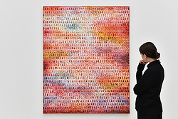 """© Licensed to London News Pictures. 13/09/2017. London, UK. A woman views """"Aggregation 14 (Dream 21)"""", 2014, by Kwang Young Chun. Preview of the START Art Fair at the Saatchi Gallery in Chelsea.  The fair showcases the best emerging artists from developing markets across the globe and is open to the public 14 to 17 September. Photo credit : Stephen Chung/LNP"""