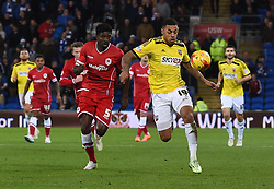 Brentford's Andre Gray is pursued by Cardiff City's Bruno Ecuele Manga - Photo mandatory by-line: Paul Knight/JMP - Mobile: 07966 386802 - 20/12/2014 - SPORT - Football - Cardiff - Cardiff City Stadium - Cardiff City v Brentford - Sky Bet Championship