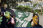Caracas, Venezuela<br />School kids in the poor Caracas barrio of 23 de Enero (23 January ) pass a mural of president Hugo Chavez (right) and Pancho Villa (centre) and Che Guevara (left). Large murals depicting Chavez alongside other Latin American revolutionary leaders are sprouting up in Caracas, part of a growing cult of personality centred around Chavez.