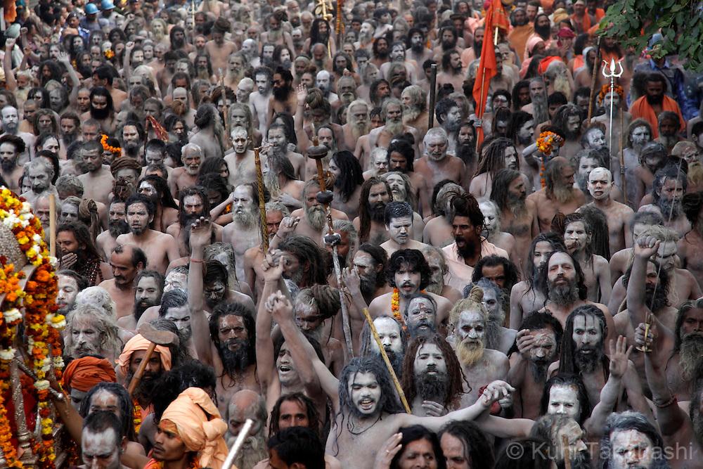 Sadhus (holy men) march on the street in Haridwar, India on Feb 2010 during Kumb Mela, largest Hindu gathering in the world.<br /> Photo by Kuni Takahashi