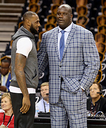 The Cleveland Cavaliers' LeBron James, left, chats with former teammate Shaquille O'Neil before warm-ups ahead of Game 4 of the NBA Finals against the Golden State Warriors at Quicken Loans Arena in Cleveland on Friday, June 9, 2017. (Photo by Phil Masturzo/Akron Beacon Journal/TNS) *** Please Use Credit from Credit Field ***