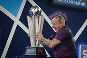 WINNER Peter Wright (Scotland) celebrates, about to lift the Sid Waddell trophy, after his win over Michael Van Gerwen (Netherlands) (not in picture) in the final of the PDC William Hill World Darts Championship at Alexandra Palace, London, United Kingdom on 1 January 2020.
