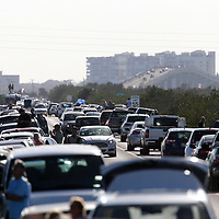 Traffic is backed up on the roadway in the Merritt Island National Wildlife Refuge in preparation of a SpaceX Falcon Heavy inaugural test on Tuesday, February 6 2018 in Titusville, Florida. The high-power launcher also boosted Elon Musk's electric Tesla sportswear into deep space. (Alex Menendez via AP)
