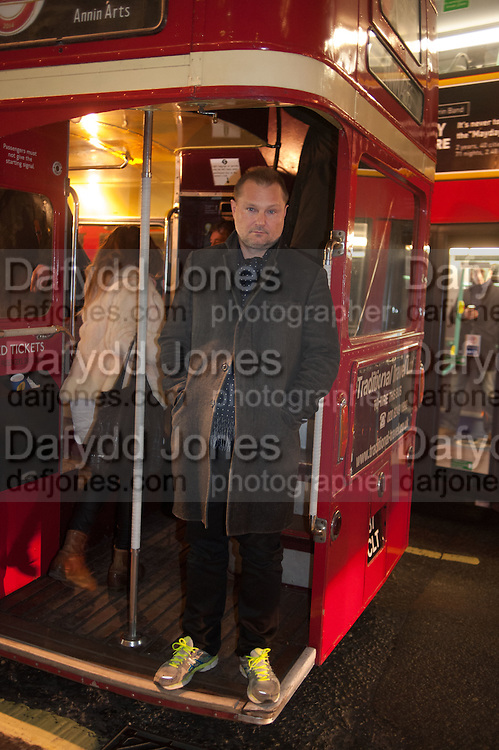JUERGEN TELLER, BUS STOPS, Juergen Teller: Routemaster Bus to view and exhibition of Juergen Teller Photographs on the roof of Bus Stops.  , The Strand, London. 13 February 2014.