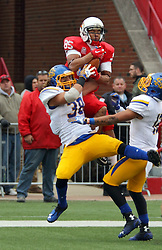 04 October 2014: Lechein Neblett elevates over Jake Gentile and Trey Carr (DB) in a reception in the end zone during an NCAA FCS Missouri Valley Football Conference game between the South Dakota State Jackrabbits and the Illinois State University Redbirds at Hancock Stadium in Normal Illinois