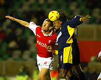 Photo. Chris Ratcliffe<br />Wimbledon vRotherham . FA Nationwide 1st Division. 06/12/2003<br />Mikele leigertwood of wimbledon and chris swailes of rotherham go up for an aerial ball