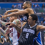 Miami Heat's Chris Anderson (11) fights for the rebound with Orlando Magic's Channing Frye (8) and Willie Green during the first half of an NBA basketball game in Orlando, Fla., Saturday, Nov. 22, 2014. (AP Photo/Willie J. Allen Jr.)