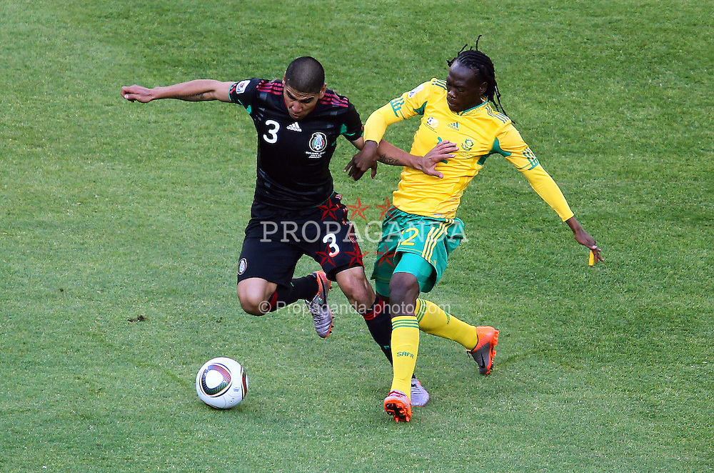 JOHANNESBURG, SOUTH AFRICA - Friday, June 11, 2010: Mexico's Carlos Salcido and South Africa's Siboniso Gaxa during the opening match of the 2010 FIFA World Cup South Africa at the Soccer City Stadium. (Pic by Vid Ponikvar/Expa/Propaganda)