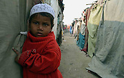 Sajida (03-years-old) is standing in front of her makeshift camp at the outskirts of Delhi State of India. More than 10,000-numbers of Burmese Rohingya Muslim refugee took shelter in Indian (Hyderabad) Andhra Pradesh, (Mewat) Haryana, (Kanchankunj) Delhi and Jammu States after ethnic strife between Rohingya Muslims and Buddhists that had been started since 1940s. Still so many peoples of aforesaid community have been living at various refugee camps in Myanmar, Bangladesh and India chiefly. Rohingya Muslims of Buthidaung, Rathedaung and Sittwe of Rakhine (formerly, Arakan) State, who ran away from Myanmar (that is, Burma) to Bangladesh to India and others South-Asian countries to escape socio-political-religious violence. (Photo/Shib Shankar Chatterjee)